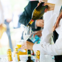 Waiter pouring champagne on a party